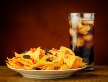 Nachos and cola drink Stock Images