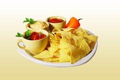 Nachos con las salsas Imagen de archivo libre de regalías