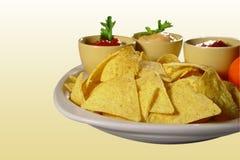 Nachos con las salsas Imágenes de archivo libres de regalías