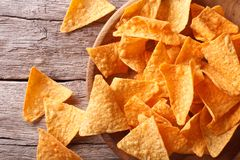 Nachos corn chips in the bowl close-up. Horizontal top view Stock Image