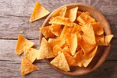 Nachos corn chips in the bowl. Horizontal top view. Nachos corn chips in the bowl on the table. Horizontal top view Stock Images