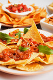 Nachos, corn chips with chili sauce Stock Images
