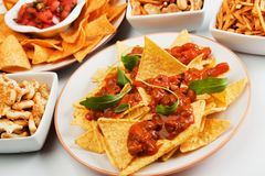 Nachos, corn chips with chili sauce Royalty Free Stock Photography