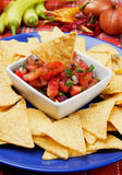 Nachos, corn chips with chili sauce Royalty Free Stock Images