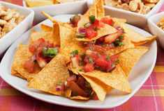 Nachos, corn chips with fresh salsa Royalty Free Stock Photography
