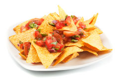 Nachos corn chips with homemade salsa. Nachos corn chips with fresh homemade mexican salsa Royalty Free Stock Images