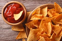 Nachos corn chips with spicy sauce close-up. horizontal top view Royalty Free Stock Photos