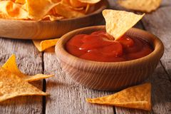 Nachos corn chips with spicy sauce closeup. horizontal Royalty Free Stock Image