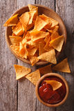 Nachos corn chips with spicy sauce. vertical top view Royalty Free Stock Photos