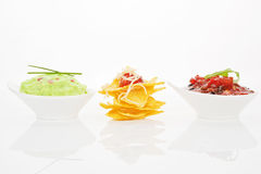 Nachos with different dips isolated. Stock Photos