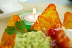 Nachos e candela Immagine Stock