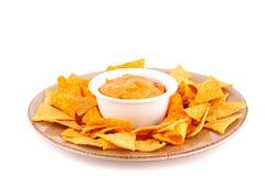 Nachos e molho de queijo Fotografia de Stock