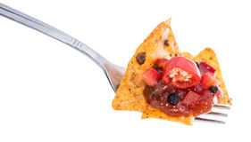 Nachos on a fork against white Royalty Free Stock Image