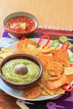 Nachos with fresh guacamole, pepper and salsa Royalty Free Stock Photography