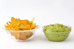 Nachos and guacamole avocado. Traditional Mexican snack. Isolated photo Stock Images