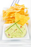 Nachos with guacamole dip. Stock Photo