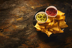 Nachos, guacamole and salsa dip with copy space Stock Images