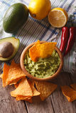 Nachos, guacamole sauce and ingredients close-up. Vertical Royalty Free Stock Photography