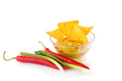 Nachos, guacamole sauce and vegetables Stock Images