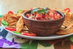Nachos with hot tomato salsa Stock Photo