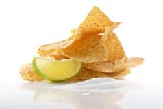 Nachos with lime and sea salt. Nachos with lime and sea salt against a plain white background stock photo