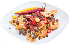 Nachos with Meat and Cheese on white Stock Photo