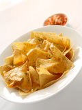 Nachos with melted cheese. Delicious, mouth-watering Mexican appetizer Royalty Free Stock Images