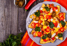 Nachos with melted cheese sauce, jalapeno, chicken and vegetable Stock Photos