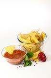 Nachos mexicanos con salsa caliente Imágenes de archivo libres de regalías