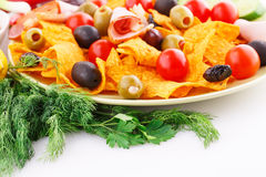 Nachos, olives, pork loin and vegetables Royalty Free Stock Photos