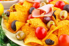 Nachos, olives, pork loin and vegetables Royalty Free Stock Photo