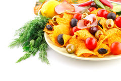 Nachos, olives, pork loin and vegetables Stock Image