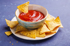 Nachos on plate and red sauce Stock Photography