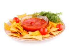 Nachos  and red sauce Royalty Free Stock Photos