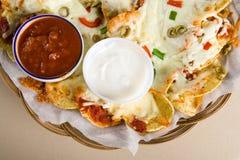 Nachos and salsa. Big nachos and salsa sauce Royalty Free Stock Photo