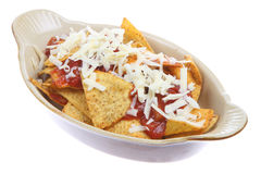 Nachos with Salsa and Cheese. Corn nachos with tomato salsa and grated cheese Stock Image