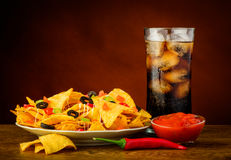 Nachos, salsa dip and cola drink Stock Photo