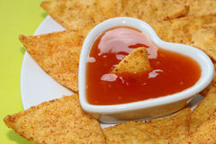 Nachos with salsa in a heart bowl Royalty Free Stock Photo
