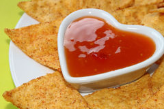 Nachos with salsa in a heart bowl Stock Image