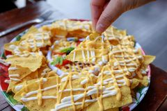 Nachos with salsa sauce stock images