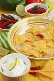 Nachos with salsa and sour cream Stock Images