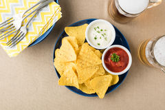 Nachos with salsa and sour cream dips Royalty Free Stock Photography