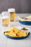 Nachos with salsa and sour cream dips Royalty Free Stock Photos