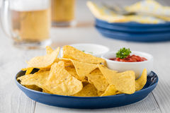 Nachos with salsa and sour cream dips Stock Images