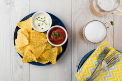 Nachos with salsa and sour cream dips Stock Image