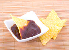 Nachos and sauce. Nachos and barbeque sauce in white ceramic bowl Royalty Free Stock Image