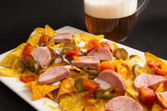 Nachos with sausage and beer Royalty Free Stock Photography