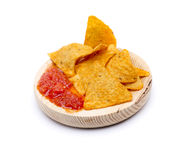Nachos. Some Mexican nachos with spicy tomato sauce Royalty Free Stock Photo