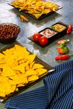 Nachos  with Tortilla chips tomato salsa, bean and mustard on rustic stone background.A textured background.Copy paste place Stock Photography