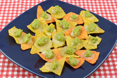 Nachos with tortilla chipsm cheee and guacalmole Royalty Free Stock Photo